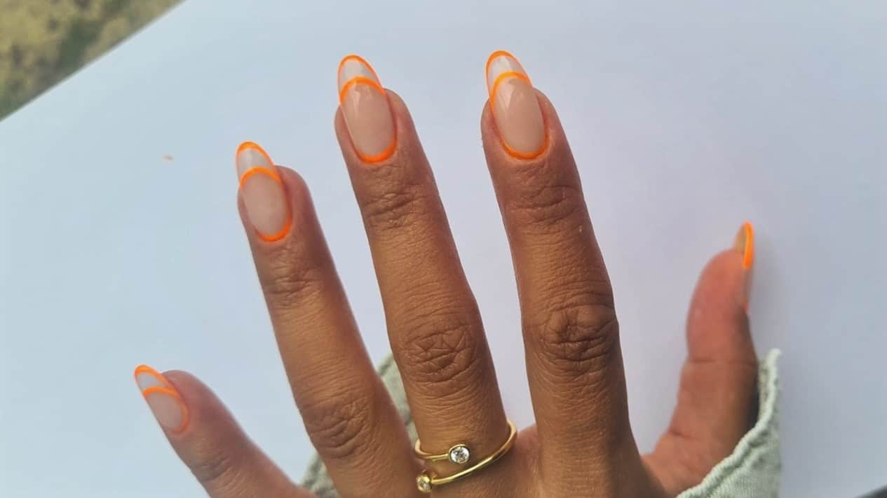 Neon orange outlined French tip